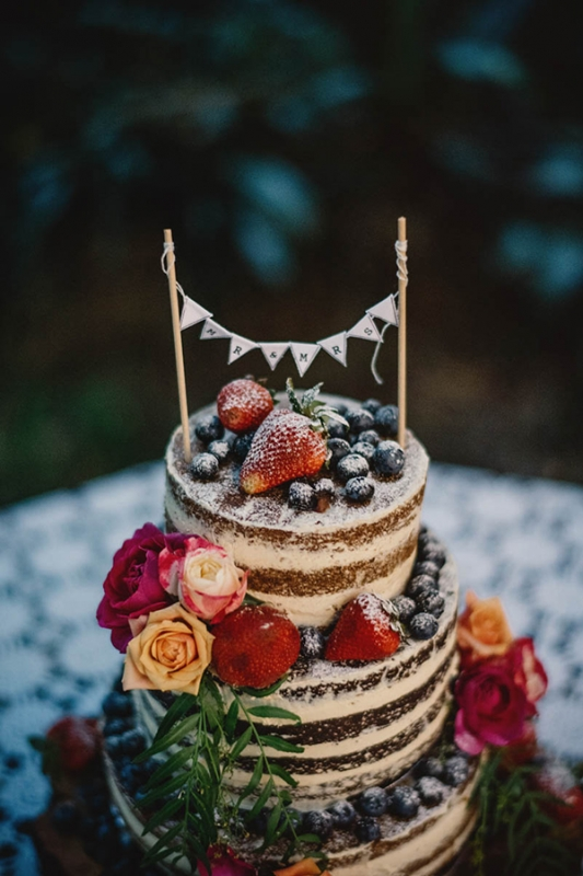 colorful eclectic backyard wedding Gabe McClintock chocolate naked cake