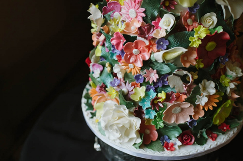 unique intricate colorful wedding cake edible flowers