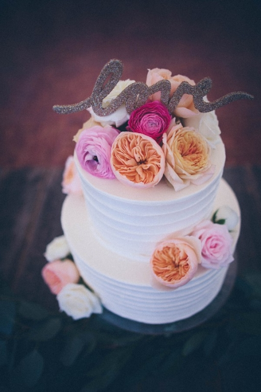 two tier white cake pastel flowers