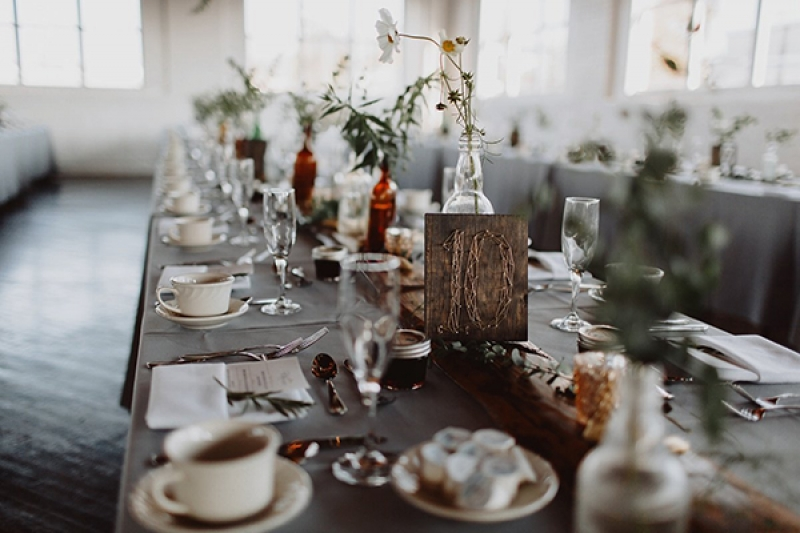 Earthy modern reception decor with greenery and tree elements