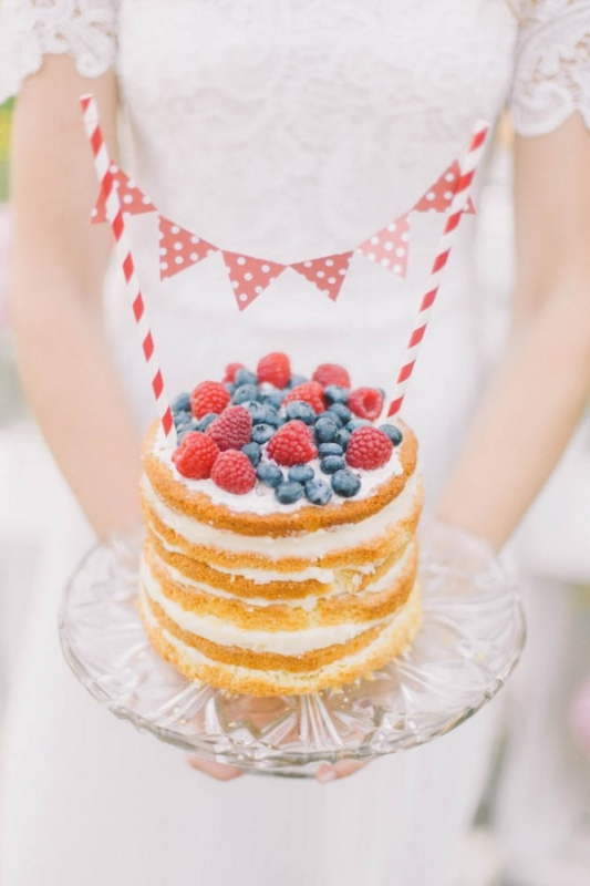 red white and blue mini naked cake with berries and bunting