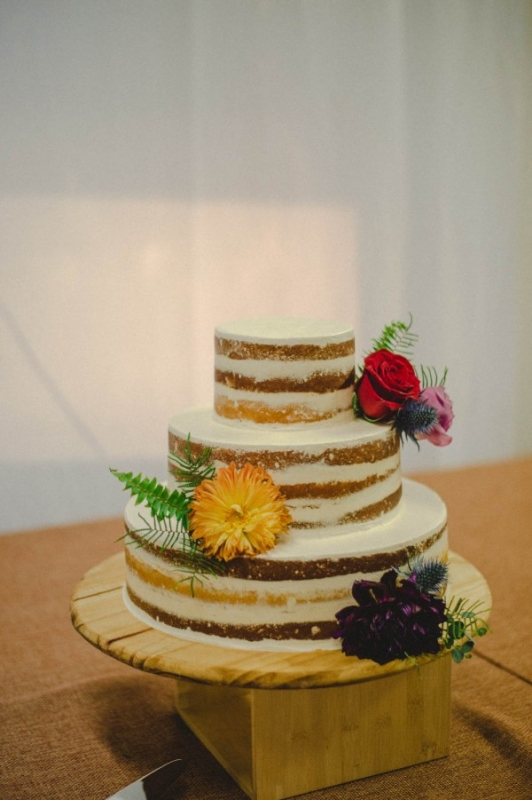 simple smooth naked cake various flowers wooden cake stand
