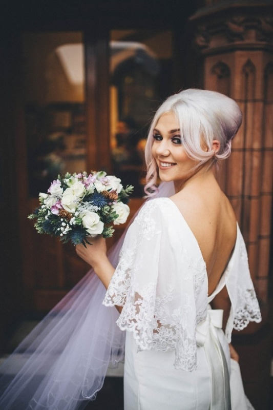 alternative bride with lavender up-do and low-back gown