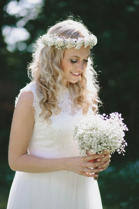 beautiful blonde bride with curled hair and a white floral crown