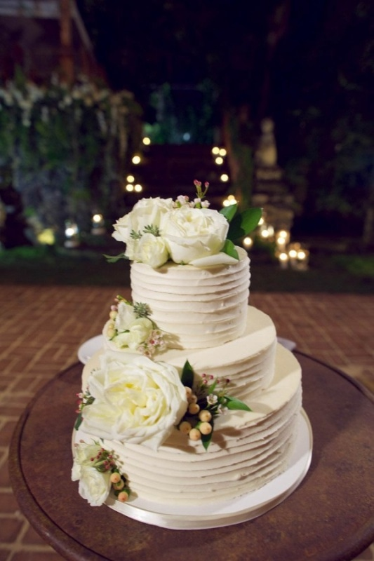 flower adorned tiered wedding cake