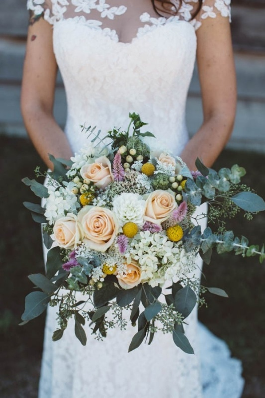 peach, white, and gold wedding bouquet