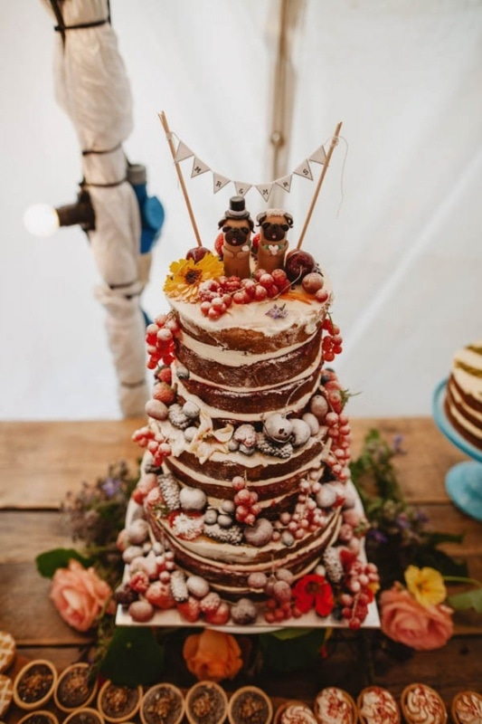 naked tiered wedding cake with berries