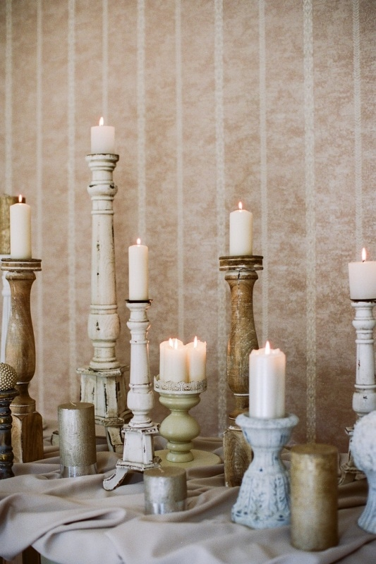 antique candlesticks at various heights