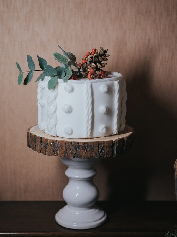 Bright White Wedding Cake with Textured Design and Red Florals