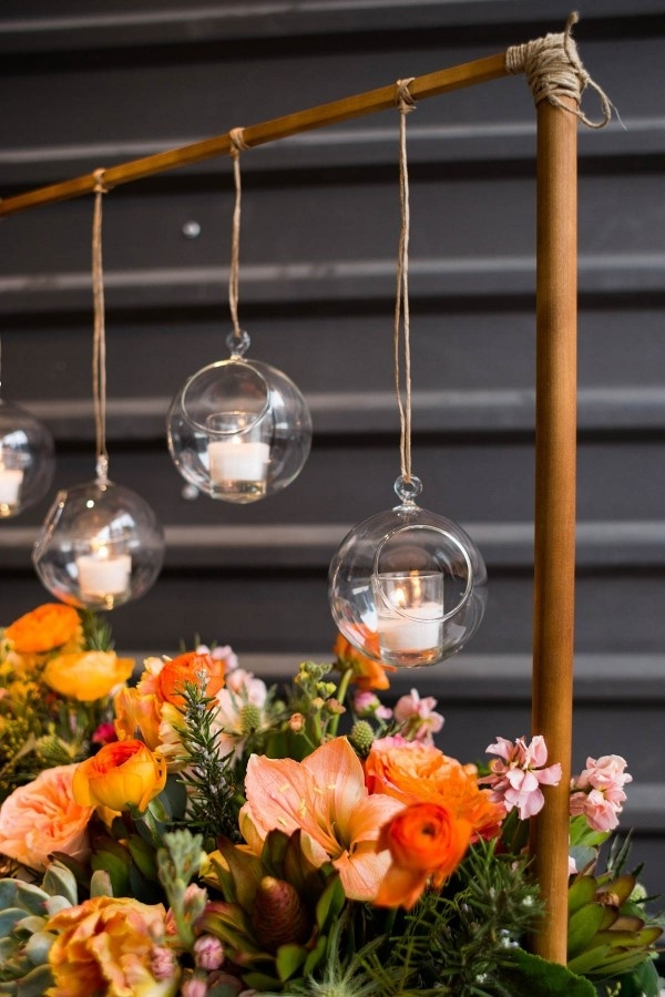 Burnt Orange and Light Pink Floral Glass Orb Copper Pipe Wedding Installation