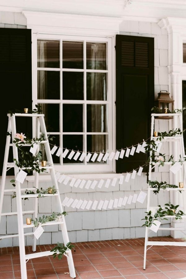 DIY Escort Card Station with Ladders and Greenery