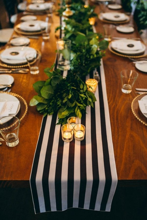 Black and White Striped Runner with Greenery and Gold Votive Candle Holders