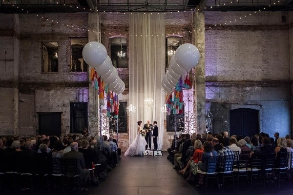 Industrial Circus-Inspired Wedding Ceremony with Large Balloon Aisle Markers