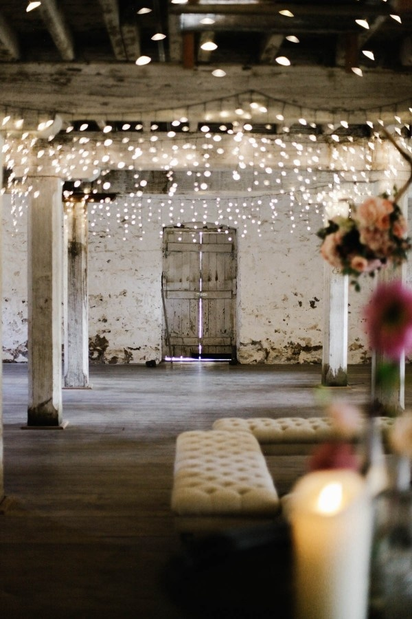 Barn Reception with Lots of Twinkle Lights, Lounge Seating, and Pink Florals