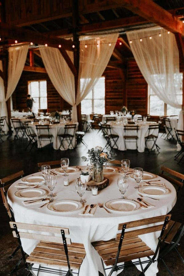 White Table Cloths and White Curtain Barn Reception Decor