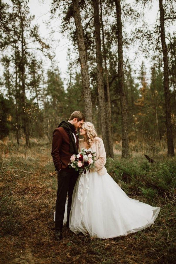 Winter Wedding Style Inspiration: Groom in a Marsala Colored Jacket and Black Scarf and Bride with a Champagne Colored Jacket