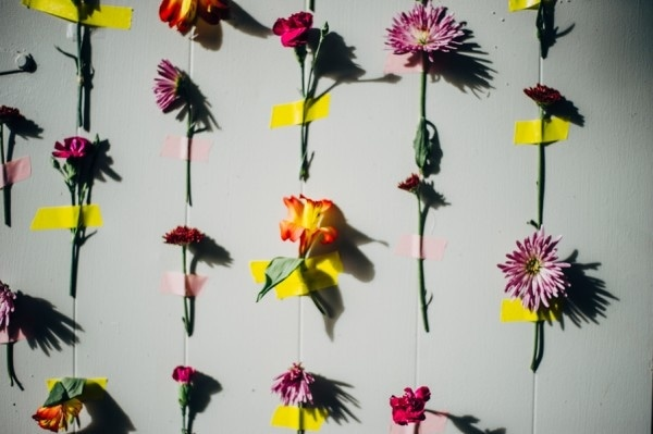 Quirky DIY Wedding Flowers Taped to Wall