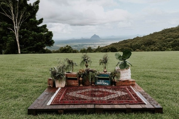 Lush Bohemian Ceremony Space with Persian Rug and Greenery Planters
