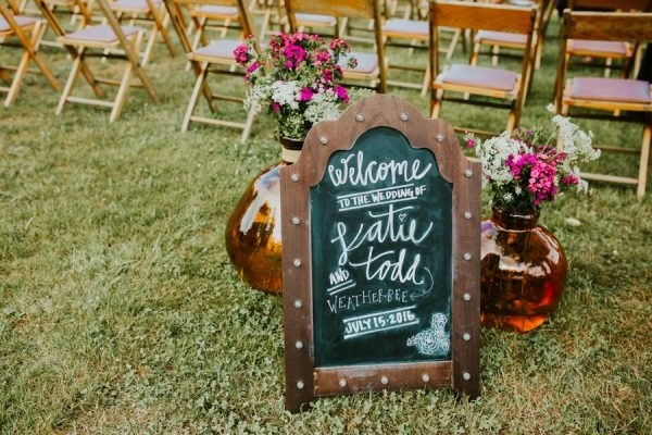 Hand Lettered Chalkboard Ceremony Welcome Sign with Amber Floral Vase Display