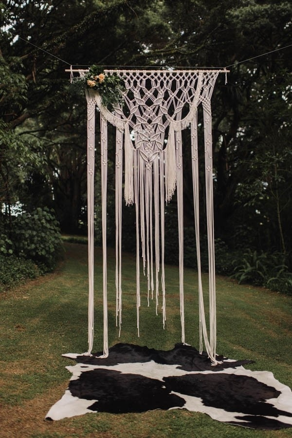Bohemian Macrame Ceremony Backdrop with Cow Hide Rug