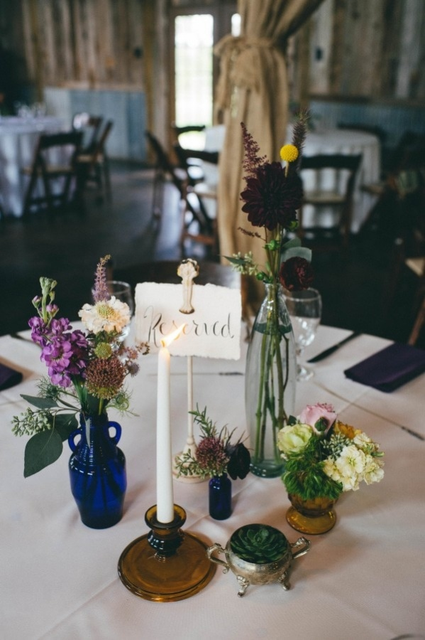Purple Green And Burgundy Floral Arrangement With Dark