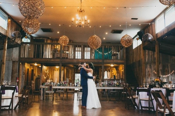 Barn Reception with Woven Globe Light Fixtures and Farm House Tables