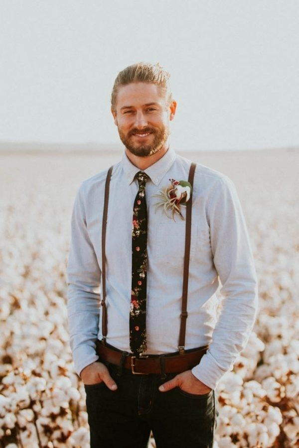 Alternative Rustic Groom Style with Floral Tie and Suspenders