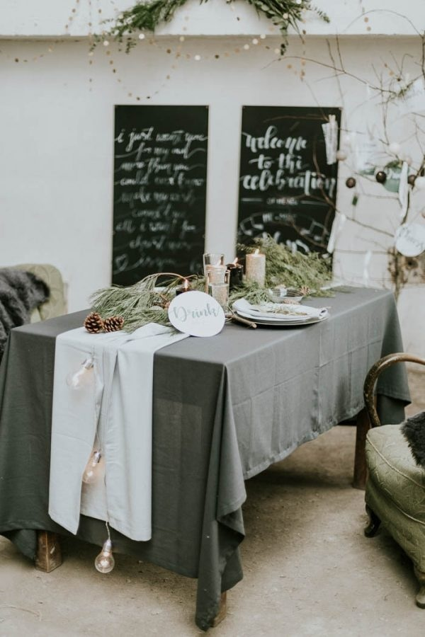 Winter Wedding Reception Table Decor with Pine Cones, Candles, and Cafe Lights