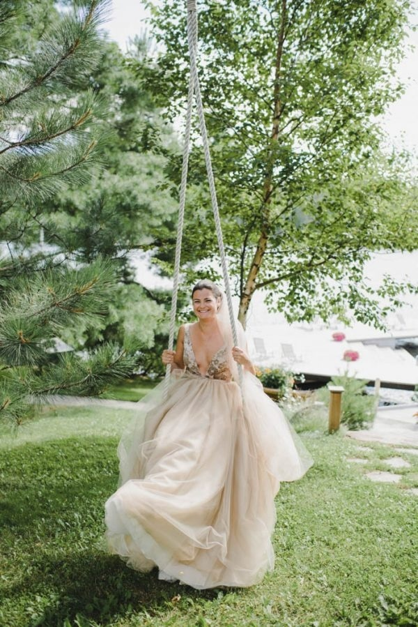 The Bride Swinging by the Lake Before the Ceremony