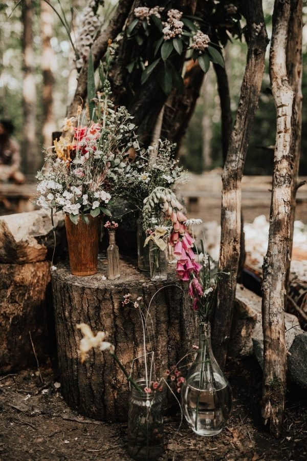 Rustic Floral Design with Wood Stumps and Wildflowers