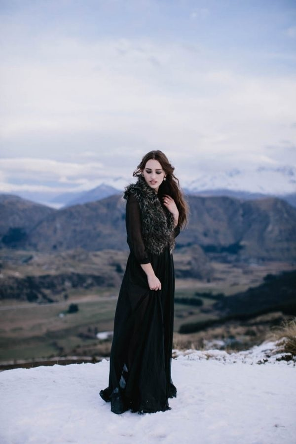 Winter Bridal Style with Black Dress and Fur Vest