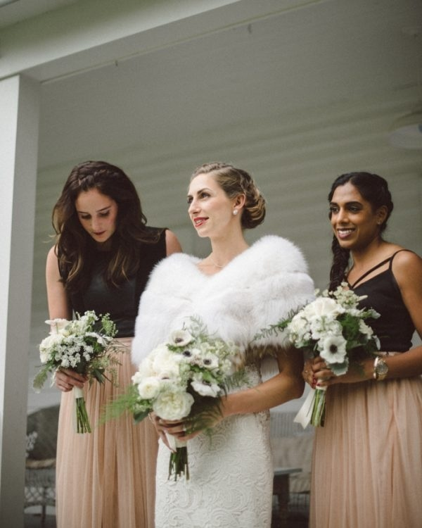 Rustic Glam Bridal and Bridesmaid Style with White Fur Stole, Blush Skirts, and White and Black Bouquets