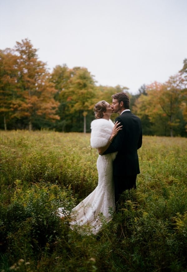 Rustic Glam Couple Portrait in Field with Bridal Fur Stole