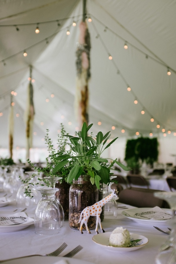 Playful Giraffe Wedding Centerpiece in Tent Reception