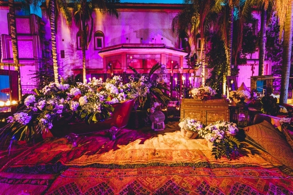Elegant Moroccan-Inspired Wedding Reception Area with Uplighting
