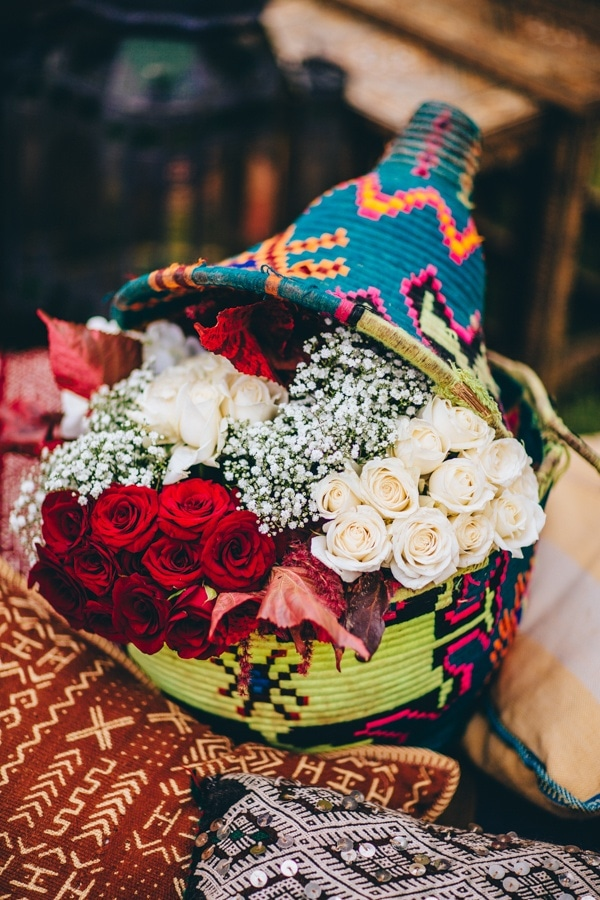 Traditional Colorful Moroccan Floral Display with Woven Basket and Roses