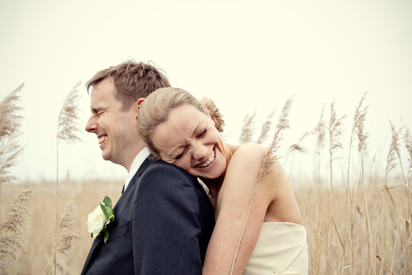 sweet portrait of laughing bride and groom by top UK wedding photographer Marianne Taylor | JunebugWeddings.com