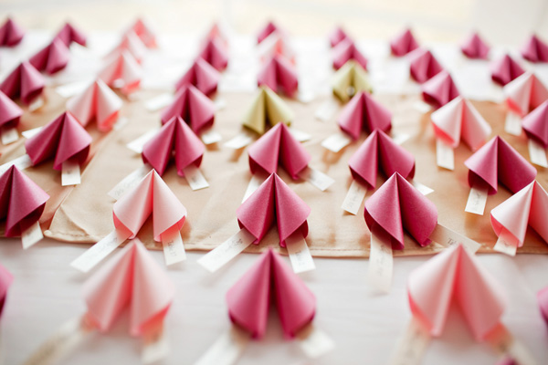 pink paper fortune cookie wedding favors - photo by top Michigan based wedding photographer Dan Stewart