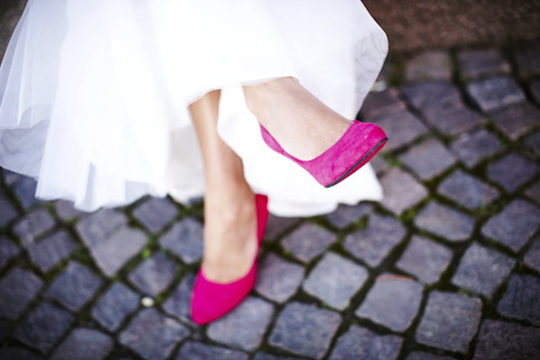 hot pink Christian Louboutin bridal shoes - photo by top Swedish wedding photographers Dayfotografi