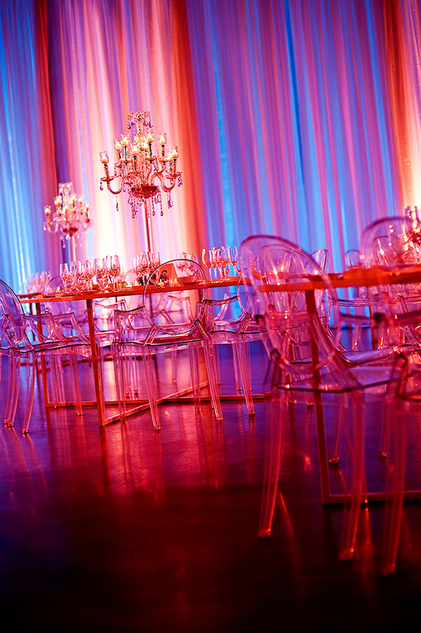 pink, purple and red ghost chair wedding decor - photo by top Canadian destination wedding photographers Davina + Daniel