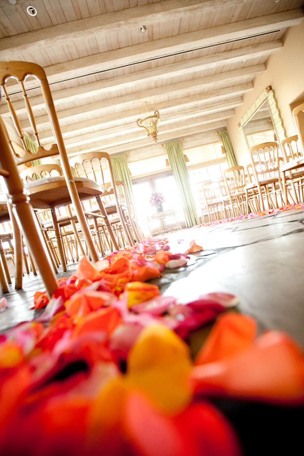 wedding ceremony aisle with pink, yellow and orange rose petals - detail photo by top Phoenix based wedding photographer Kimberly Jarman