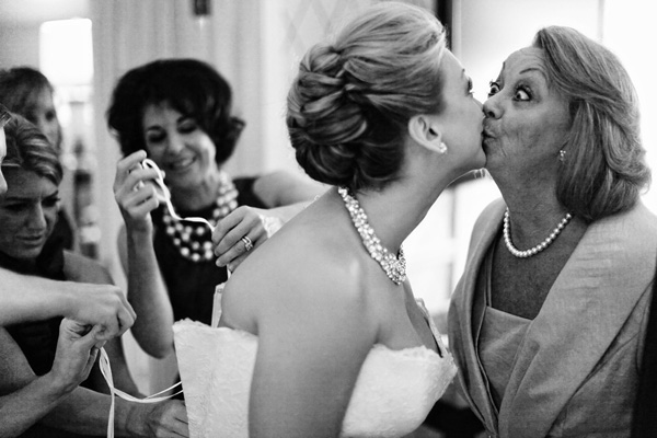 hilarious portrait of bride kissing mother while getting ready - hilarious wedding photo by Chicago-based wedding photographers The Rasers