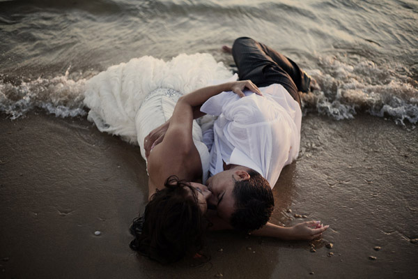 sexy beach wedding photograph by top Spain wedding photographer Francisco Rosso | junebugweddings.com