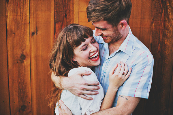 fun and playful engagement photo by Erik Clausen | junebugweddings.com