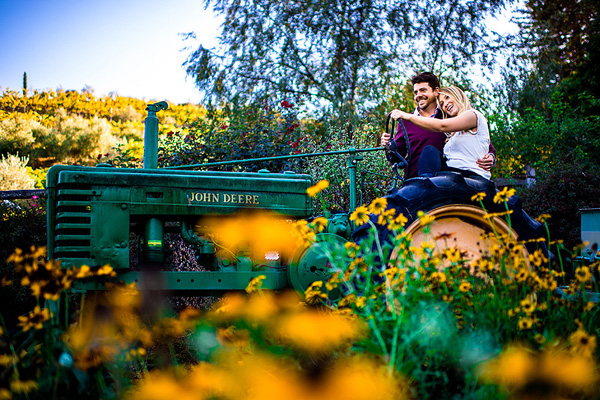 fun and playful engagement photo by Alex Zyuzikov of RedSphere Studios | junebugweddings.com