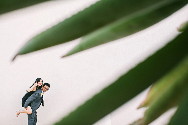 fun and playful engagement photo by Jason Tran of Jason Q. Tran Photography | junebugweddings.com