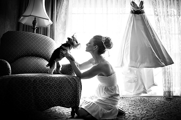 photo of bride with dog at wedding by Susan Stripling | junebugweddings.com