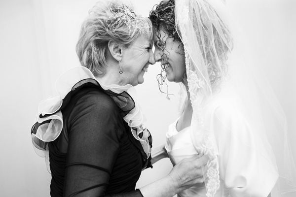 sweet mother and daughter photo by Mike Garrard, one of the best wedding photographers in the UK | junebugweddings.com