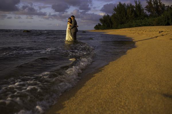 tropical destination wedding in Princeville, Kaua'i, Hawai'i, photos by Brett Butterstein Photography | via junebugweddings.com