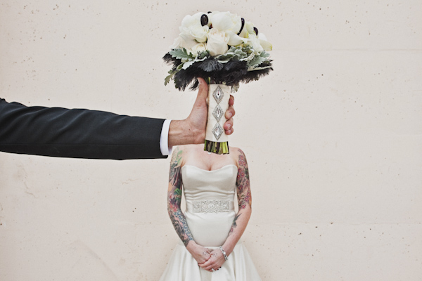 hilarious photo of groom holding bouquet in front of bride's face - genius alternative wedding portrait by Southern California photographers The Image is Found